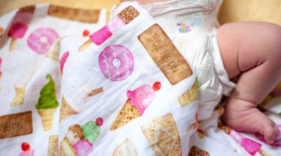 baby wearing the best pampers diapers for newborns