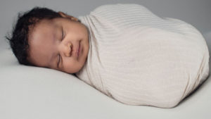 baby sleeping in biodegradable diapers